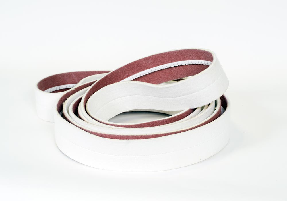 Polyester endless belt with base coating, for stretching, batching and inspection