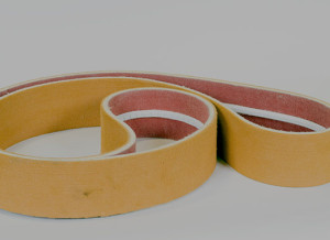 Zylon and Kevlar endless belt with base coating, for transfer and cooling, operating temp 1020 farenheit