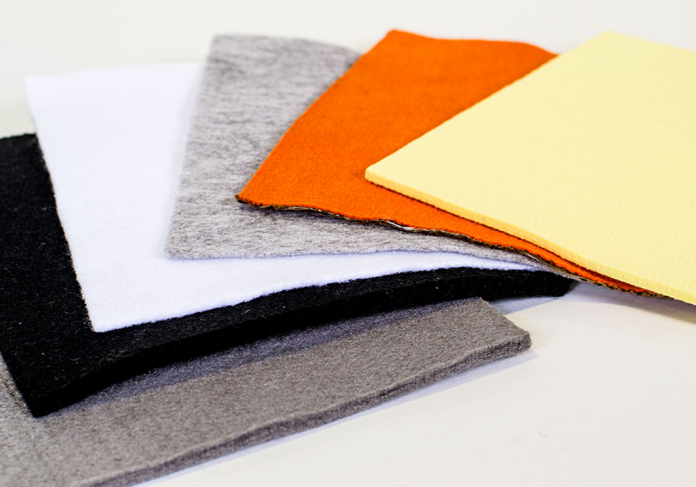 Nonwoven fabric, performance fabrics, industrial fabrics, aluminum extrusion, extrusion process, graphite alternative