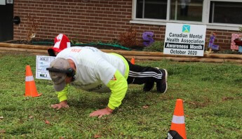 Mr. Pushup doing pushups to raise money for the Canadian Mental Health Association